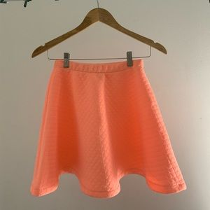 A pink-salmon high waisted skirt only worn once